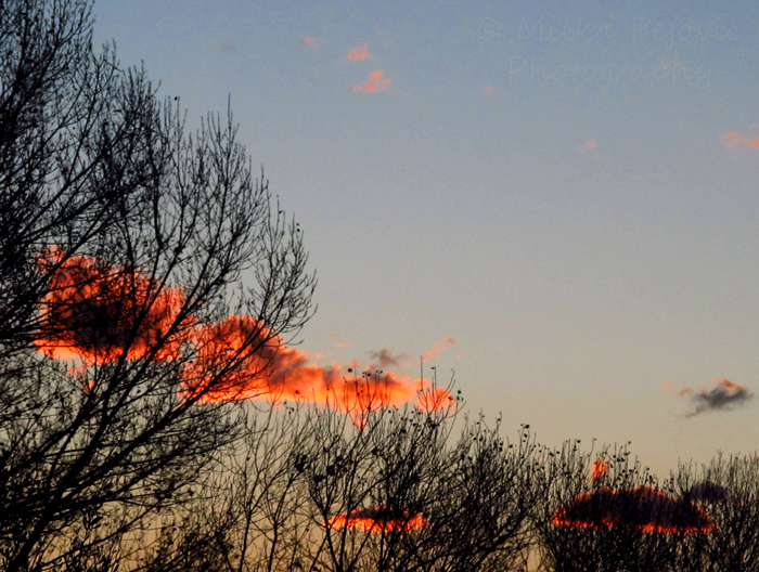 Photo of a winter sunrise - clouds on fire