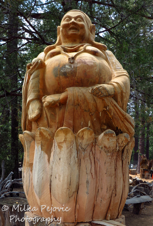 Travel theme: Sculpture - large wood sculpture of Buddha