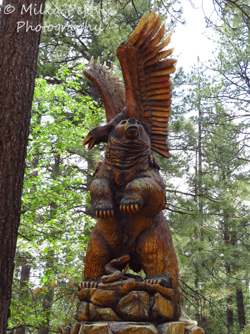 Travel theme: Wood sculpture of a lifesize bear and eagle