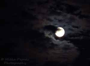 A word a week challenge: atmospheric - moon behind the clouds