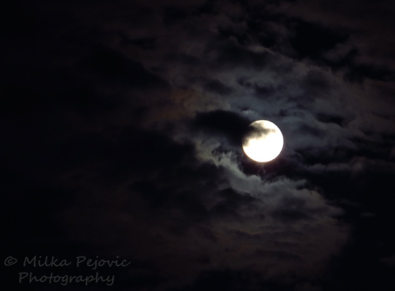 Full moon coming out from behind the clouds