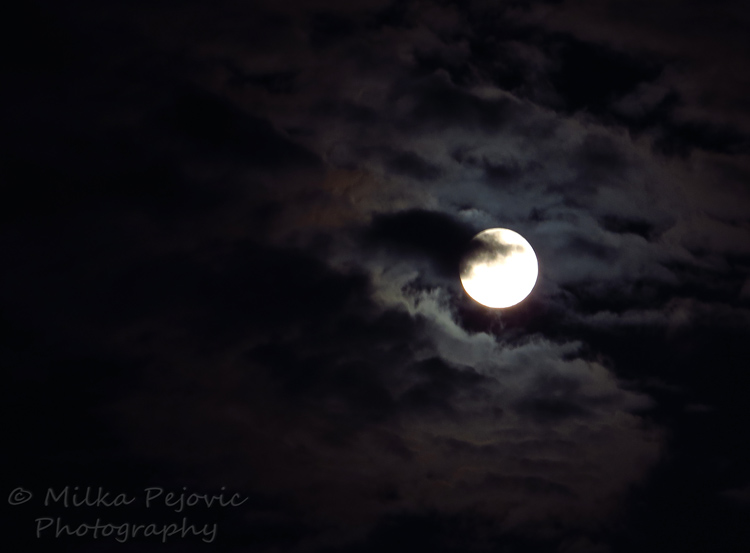A word a week challenge: atmospheric - moon behind the clouds