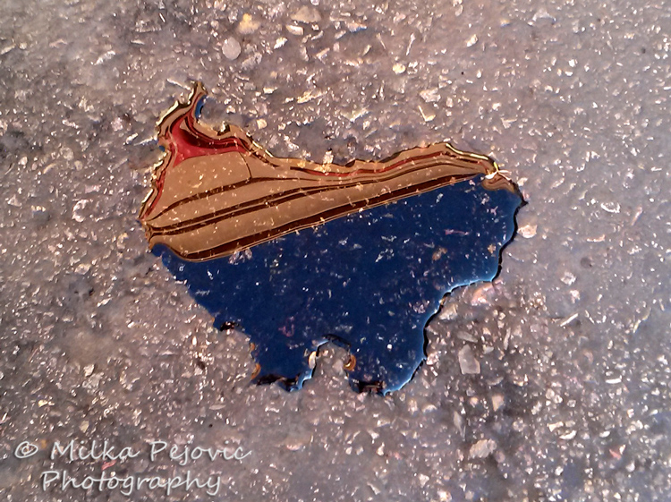 Water puddle in the shape of the United States