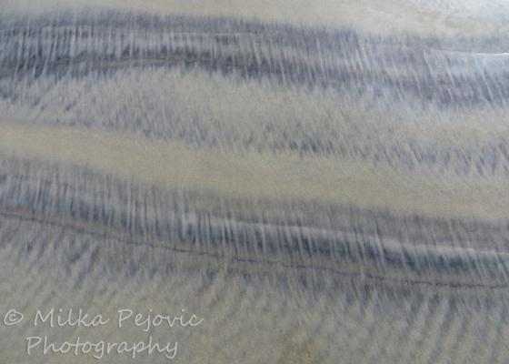 Patterns in wet sand: dark and light sand
