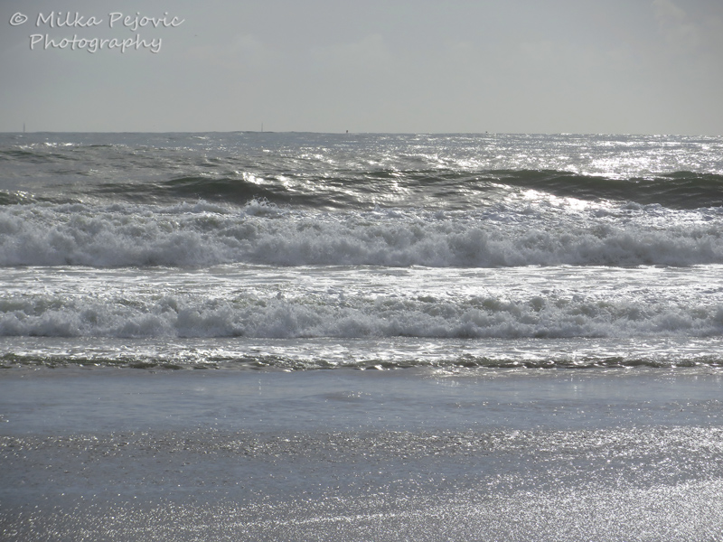 Waves of the Pacific Ocean on a cloudy day